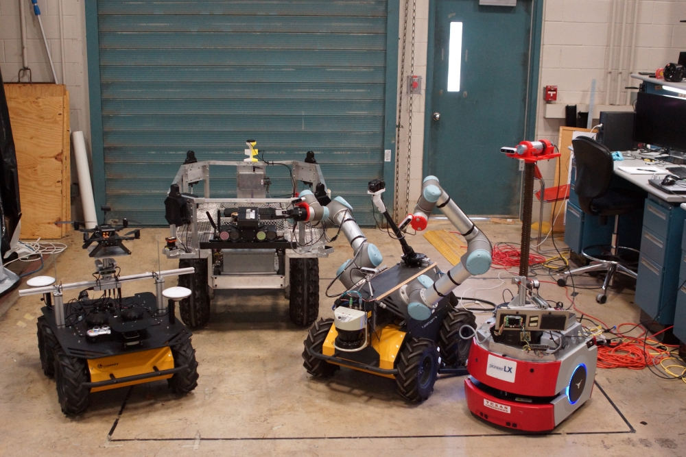 photo of four robots on floor