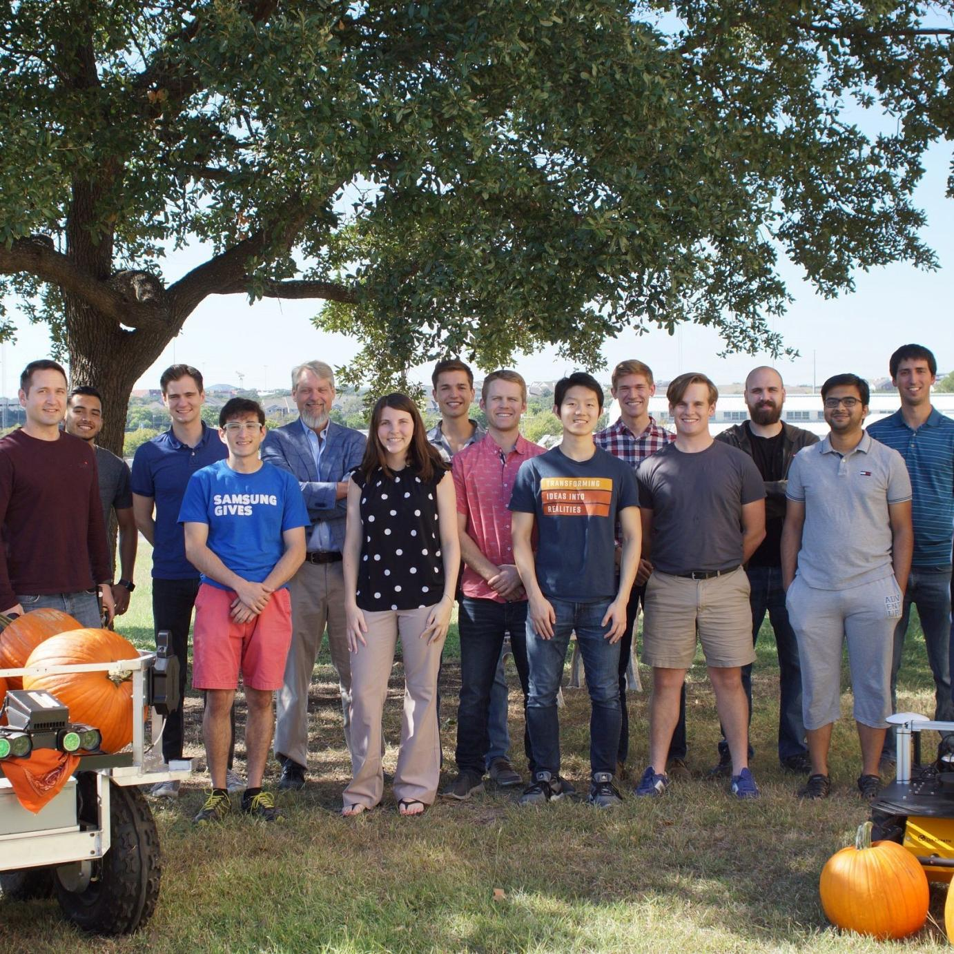 photo of the robotics group standing outside